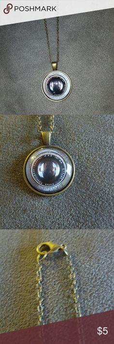 Camera Lens Necklace Faux camera lens necklace. Jewelry Necklaces