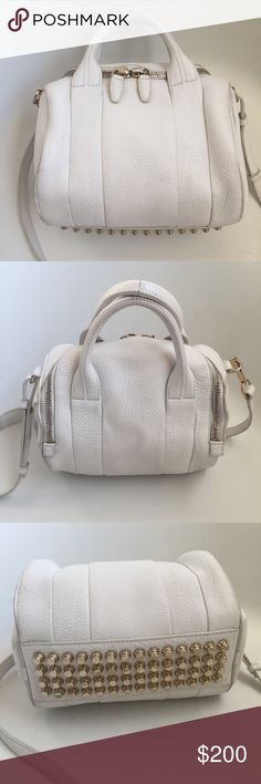 Alexander Wang Rockie Crossbody Satchel Bag Purse Alexander Wang Rockie Crossbody Satchel Bag/Purse. White pebbled leather with GOLD Hardware (rare). Good preowned condition. Normal wear. No issues just used. No rips or tears. Great bag! Alexander Wang Bags Crossbody Bags