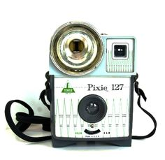 The Pixie 127 camera, by Tower, was a tiny little jewel made in U. which used 127 film. The camera, which was high on fashion in the had a integral flash port, a bulb release lever and a switch for color or black and white. Reflex Camera, Toy Camera, 35mm Camera, Camera Gear, Antique Cameras, Old Cameras, Vintage Cameras, Lomography, Photography Camera