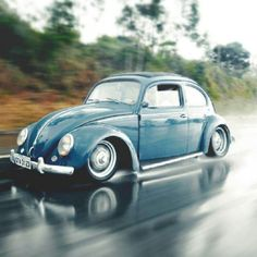 Lowered ragtop VW Bug in the rain
