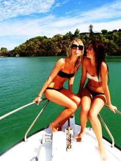 this reminds me of Beth Anne and I in the summer on the lake with our family :)