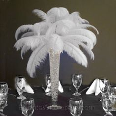 There is something very appealing about this. It is not as expensive as flowers, and won't die in a week... Center piece idea!