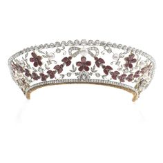 This recently came up for auction & went for well over estimate. Garnet,natural pearl,cultured pearl & diamond tiara, Aage Dragsted, 1930s Of floral & foliate design,set w/pear-shaped & circular-cut garnets, a central natural pearl measuring 10.48 x 10.68 x 7.44mm, button-shaped cultured pearls & cushion-shaped,circular,single-cut & rose diamonds, inner circumference approx 380mm,unsigned,the detachable diamond rivière surmount may be worn separately, length approx 465mm, screwdriver…