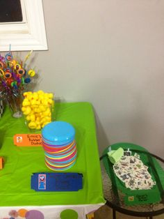 Hoppers store- Sesame Street party goody table pt5 Mini rubber ducks, flying discs, tattoos