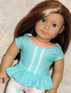 American Girl Doll® Handmade Top Fashion flair with a feminine touch! Your doll is sure to stand out in this trendy Peplum Top. Featuring lace trim and lace overlay collar, it adds just a hint of the
