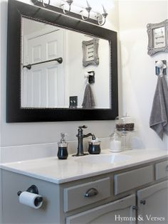 I like the towel bar on back of door and TP holder on side of vanity