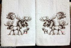FOUR SKETCHED MOOSE - 2 EMBROIDERED HAND TOWELS by Susan                                  1