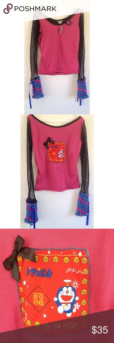 Anime pink top long sleeves detail on back NWT This super cute NWT pink top from Indiscretion  has long black fishnet sleeves with crochet and ribbon detail indiscretion Tops Blouses