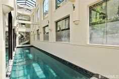 Swimming pool in your house along the kitchen and living area...  An oasis in the heart of San Francisco, this extraordinary home blends architectural drama with world-class views, seclusion and greenery http://www.zillow.com/homedetails/1335-Stanyan-St-San-Francisco-CA-94114/67447690_zpid/