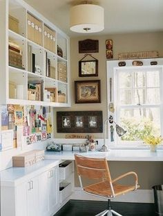Gorgeous clean craft/office area. Love the wall cubbies.
