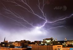 UNITED STATES, Washington : Lightning brightens the night sky over  Washington, DC, during a rainstorm on April 20, 2015. AFP PHOTO /  MLADEN ANTONOV