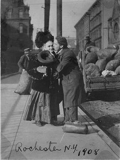 Harry Houdini adored his mom, and he takes off his hat and leans in to give her a kiss. Here they are in Rochester, NY in1908, a cart behind them being loaded up with the big burlap sacks. I love this image.
