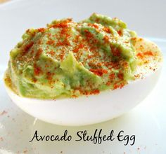 Want to make an easy and delicious stuffed egg?  Simply add avocado and you have a tasty and healthy stuffed egg. The color looks like Spring! #stuffedegg