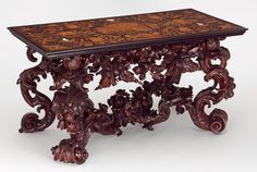 Table, top by Lucio de Lucci, base possibly by Andrea Brustolon, about 1686, Italy (Venice), marquetry top in European and tropical hardwoods, with stained horn, ivory and pewter details; boxwood base, Museum no. W.6-2012, © Victoria and Albert Museum, London
