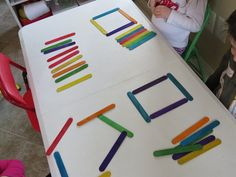 Lining up colored craft sticks by Teach Preschool