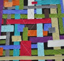 A CROSSROADS Denim wall hanging shown at Portland Quilt Market in Indygo Junction's booth Inspiration!