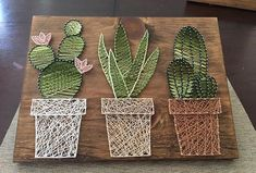 Welcome to my shop! Im a mother of two taking advantage of nap-time by creating amazing conversational piece string art. Each piece is cut, sanded, stained by me, customized by you and enjoyed by all. Cactus Garden This piece is measured at 11 inches tall and 14 inches wide. Saw #artsandcraftsshop,