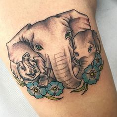 Elephant Family Tattoo with Flower Designs - Best Elephant Tattoos: Cute Elephant Tattoo Designs and Cool Ideas s sforwomen ideas designs Elephant Family Tattoo, Mandala Elephant Tattoo, Watercolor Elephant Tattoos, Elephant Tattoo Meaning, Cute Elephant Tattoo, Elephant Tattoo Design, Mommy Tattoos, Mother Tattoos, Mother Daughter Tattoos