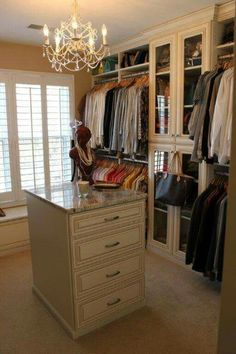 Wouldnu0027t You Love To Hang Out In This Master Closet? With Marble Top Center  Island, Chandelier, Window Seat And Glass Front Cabinets, This Dressing  Area Is ...