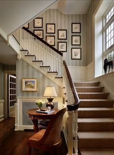 Staircase Photo Wall - Black and white photos and simple matching frames make this photo wall interesting, not overwhelming