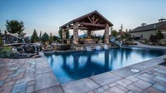 This rustic luxury backyard space was designed to be fully wheelchair-accessible. It includes a gazebo with outdoor kitchen, swimming pool, gorgeous mountain views and even a waterslide. Stone pavers are used throughout the space to create gentle slopes, making it easier to navigate for a homeowner with limited mobility.