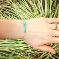 GIVEAWAY!  I'm excited to announce that @idleweiss.creations will be giving away one turquoise bar bracelet! This dainty bracelet looks wonderful on its own, or works amazingly as a layering bracelet.  This bracelet will be customized to fit YOU! Valued at $30 and made with sterling silver, you'll want to wear this little gem. Speaking of gems, did I mention it was made of real turquoise? Gorgeous!