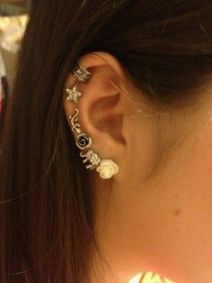 Nicely decorated with multiple ear piercings