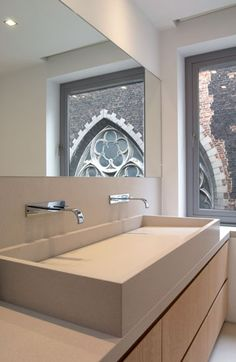 :: BATHROOMS - adore the work of Ensemble & Associés - Architectes d'Intérieur - Projet Botanique. Lovely custom sink detail with vanity featuring flush finger pull drawer details. Why both with 2 sinks when you have have 1 beautiful oversized sink .... #bathrooms