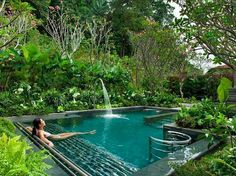 A pool with a waterfall tropical spa style at home