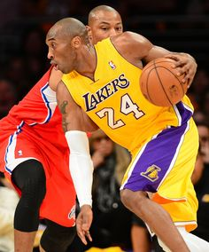 BKN-NBA-CLIPPERS-LAKERS  Kobe Bryant of the LA Lakers drives against the LA Clippers during their NBA game in Los Angeles, California on February 14, 2013. AFP PHOTO / Frederic J. BROWN (Photo credit should read FREDERIC J. BROWN/AFP/Getty Images)