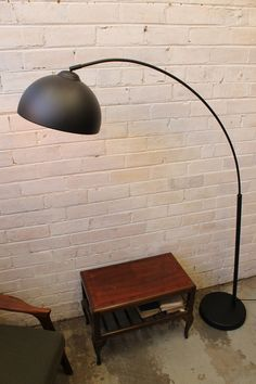 Arc-style floor lamp, great for industrial living rooms! Available in Australia via our online store: http://www.fatshackvintage.com.au/collections/lighting/products/arc-floor-lamp