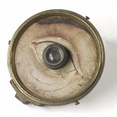 Model eye, glass lens with brass-backed paper front with hand-painted face around eye, by W. and S. Jones, London, 1840-1900