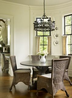 Lightweight wicker chairs keep the breakfast room casual.