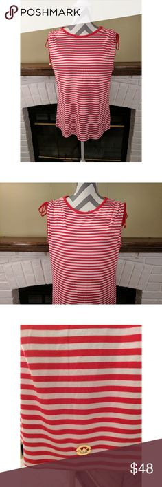 """Michael Kors Macintosh Striped Tee NWT Michael Kors Macintosh tee with red and white stripes. Shoulders tie up and have gold plated grommets at the end of each tie. 95% viscose 5% elastane. Measurements laying flat are bust: 20"""", length: 26"""". 🚭 Smoke free home. Michael Kors Tops Tees - Short Sleeve"""