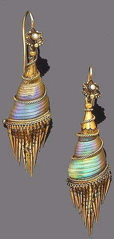 A pair of shell and gold earrings, circa 1870 Each floral surmount with half-pearl detail, to a vertically set iridescent seashell within a scrolling rope twist frame and an articulated tassel of polished tapering links, length 5.8cm.
