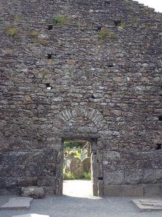Celtic graveyard from inside church ruins. Glendalough.