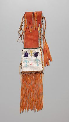 Tobacco Bag Date: ca. 1890 Geography: United States, Oklahoma Culture: Southern Arapaho Medium: Native-tanned leather, glass and metal beads, pigment