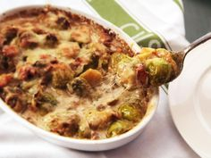 Over-the-Top Creamed Brussels Sprouts Gratin- so yummy!  wonder if I can lighten it with milk instead of cream?