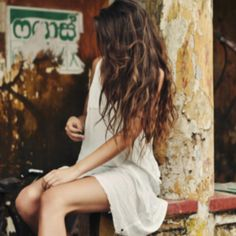 Long, messy hair and a white dress