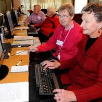 """SeniorNet tutor Val Steele (second from right) guides Mavora Kelly at a computer ---An Otago Polytechnic initiative to bring laptops and tablet computers into the homes of elderly people aims to help solve social isolation by introducing them to online social media, chief executive Phil Ker says."" #ConnectedAging #Perspective"