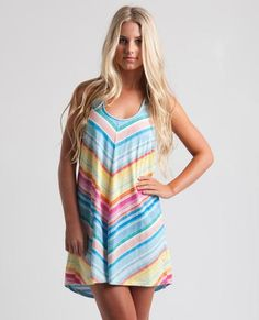 SUN DIP COVER UP // vanilla -  This beachy high-low hem cover-up is perfect for throwing on over your swimsuit at the beach