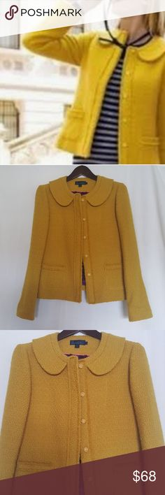 ⬇️Boden Mustard Gold Wool Boucle Parisienne Jacket Boden Mustard Gold Wool Boucle Parisienne Jacket This jacket is a true wardrobe essential. The Peter pan collar and popper fastening keep things effortlessly chic. Versatile and modern with patch pockets and cropped length. Beautiful satin contrast lining.  Near New condition  Measures 23 inches in length. Boden Jackets & Coats