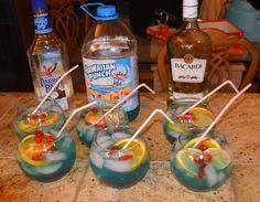 Easy Fishbowls   fish bowl, straws , maraschino cherries and Swedish fish at the dollar store. ~1Hawaiian Punch Berry Blue Typhoon, 1 Parrot Bay Coconut Rum, 1 Bacardi Silver,1 orange, 1 Lime and 1 Lemon at safeway or any other store that may have these. sprinkle some Swedish fish in the bottom of the bowl add ice pour two shots of Parrot Bay and 2 shots of Bacardi pour the Hawaiian punch to desired amount  . Add 3 cherries 1 slice of Lemon, Lime and Orange add straw and enjoy !!