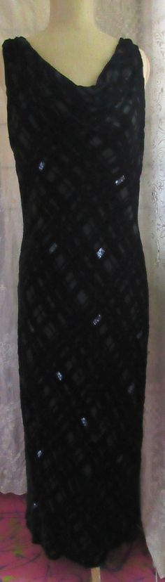 WOW.  This is a knock out of a dress. It is a 90s version of 30s elegance and Valerie Stevens hit the nail on the head.  It is a silk and rayon devore velvet, with scatterings of bead work. The gown is cut on the boas so it slips over the head, no zippers. It has that movie star draped neckline in front, and also in back, but cut deeper for pure glamour. The entire dress is pure drama. Wear this, and you command the room. Remarkable, it is a size 16. Because of the bias cut, it stretches…
