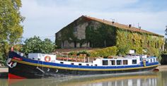 Luxury Hotel Barge Anjodi Cruises the Canal du Midi in France   - Explore the World with Travel Nerd Nici, one Country at a Time. http://TravelNerdNici.com