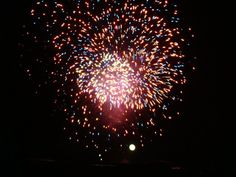 Selena Michelle contributed this photo of the moon behind Fourth of July Fireworks at Library Park.