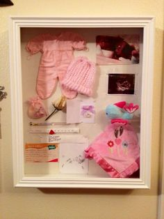 Shadow box #2.  This box contains my last sonogram where we saw her flatline. It also has the outfit and hat provided by the hospital that fit her. A ring from the hospital in honor of her life, the lovey blanket she was delivered on, a bag of baby memorables provided by the hospital, her hand and foot prints, mine and her hospital bracelets, the rose that symbols a baby did not make it and a picture of her.