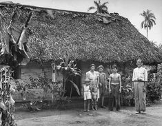 1944 A cane cutter and his family standing in front of their home. | The Havana high life, before Castro and the Revolution