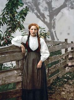 You are viewing a rare image of A girl of Voss, Hardanger. This color photochrome print was taken between 1890 and 1900 in Fjord, Norway.