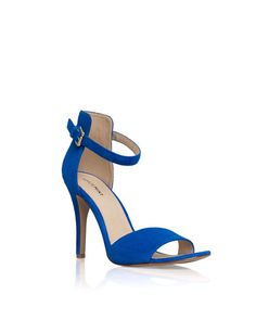 The Bovary - A classic high-heeled sandal gets modern flair with a thick in the back, thin in the front ankle cuff.